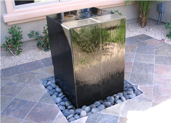 Diy fountain or water feature live learn invest Diy wall water feature